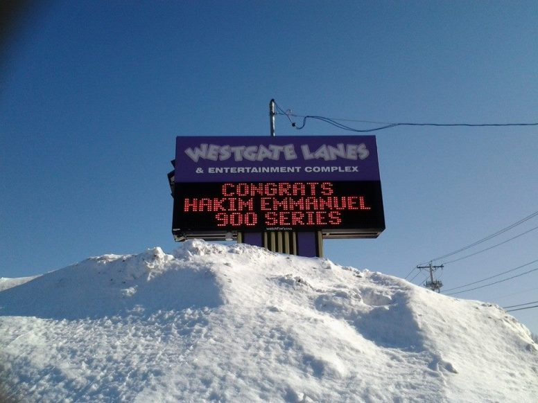 The outdoor sign congratulating Hakim Emmanuel on his 900 series. The pile of snow in the foreground adds to the effect, giving the impression that he conquered the historic bad weather at the time to bowl it.
