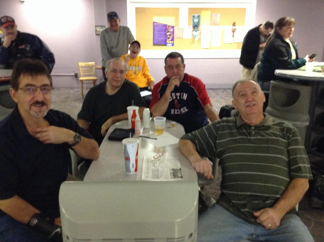 "2013-14 Coke league first third champions, ""Travis"" (L-R: Sam Kamel, Bob Hamilton, Steve Travers, Dan Robinson). The guy ""photobombing"" in the back should be familiar to Westgate Lanes bowlers, as well: Chris Berkey (that's his father Ron behind him)."